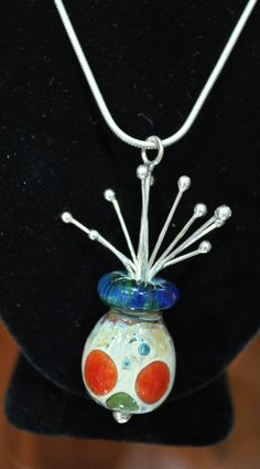 Joy Raskin  http://joyraskin.com  Joy, a silversmith since 1984, is a native of New Hampshire and has exhibited in the United States as well as Ireland and New Zealand. She makes jewelry as well as sculpture and flatware. Her flatware is in the collection at the Currier Museum of Art (Manchester, NH) and her jewelry is, or has been for sale in the Currier's Museum Shop and ranges from $35-$150.