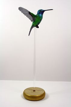 Handmade paper and resin hummingbird sculpture, available to buy here: www.etsy.com/shop/ZackMclaughlin