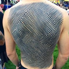 Look at this tattoo by Archie Malyugin from a certain angle and you might see the image of a skull move into appearance. #InkedMagazine #back #tattoo #tattoos #inked #ink #art