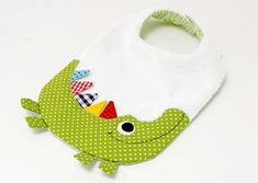 Cute crocodile bib from our crocodile collection .- Cute crocodile bib from our crocodile collection. The front of the bib is made of colorful cotton fabrics and absorbent cotton terry in white. The Babys, Baby Sewing Projects, Sewing For Kids, Toddler Toys, Baby Toys, New Baby Gifts, Gifts For Kids, Baby Bibs Patterns, Bib Pattern