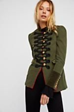 Seamed And Structured Blazer   Structured military-inspired coat with a borrowed-from-the-boys look featuring statement stitching along the front with large etched button details. * Front pockets * Contrast sleeve cuffs with buttons * Lined
