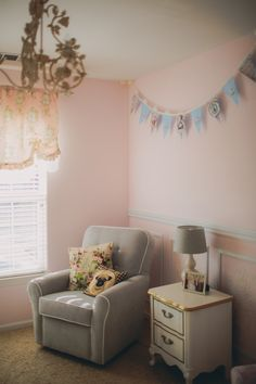 Love the gray glider in this pink French-inspired nursery!