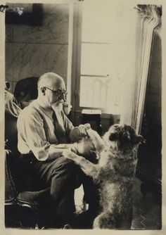 Animal-lover Henri Matisse with his dog.