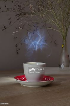 Stock Photo : Close-Up Of Steaming Coffee Cup On wooden Table