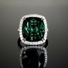 Platinum mounted 10.38ct cushion-shaped green tourmaline and diamond cluster. Made in Chichester, England. 3 Stone Rings, Wide Band Rings, Green Diamond, Diamond Art, Chichester England, 3 Stone Engagement Rings, Gold Feathers, Bespoke Jewellery, Dress Rings