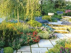 Lovely textural garden and neat flagstone and steps...and bird bath