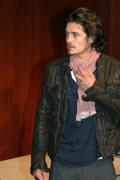 Orlando Bloom with a gorgeous pink scarf