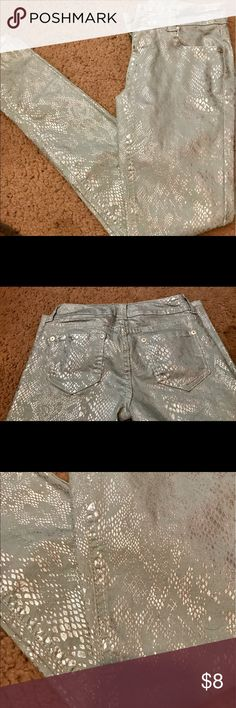Light blue and silver metallic skinny jeans (1) I am selling a pair of light blue and silver metallic skinny jeans as showed in the picture. There is nothing wrong with them at all. They are in great condition and they are a size 1. Only selling because I grew out of them. They are super cute! Wildflower Pants Skinny