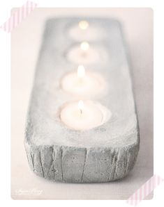Cute DIY cement candle holder. Make one yourself by pouring cement mix into a clingwrap-lined bread pan, then dropping in wrap-covered tealights.
