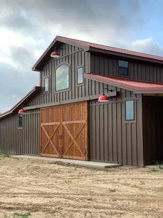 Horse barn with Hardie plank siding and cedar doors. #barn #custombarn #horsebarn