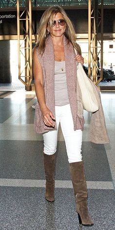 love her. and her white pants with those boots.