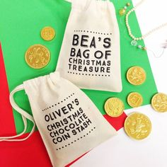 A personalised typographic mini gift bag. Fill them with little presents or sweets for underneath the Christmas tree OR hang on your tree! OR for Birthday PartiesPlease note that chocolate coins or other props used in the Photo example are not included with this product. Designed printed and packed in the UK by Claire CloseFor children or grown-ups you can fill with chocolate coins and sweet treats or for wrapping smaller gifts like Jewellery and other Christmas stocking filler toys. Also a…