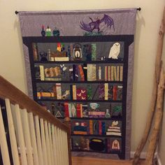My Project of Doom quilt is now hanging on my stairwell landing.  Very hard to take a pic of, but I love it so much! Free patterns available on FandomInStitches.com