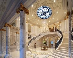 Grand entrance with a beautiful ceiling and skylight