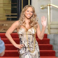Mariah Carey dresses like a man for new video!