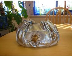 Kathy Van Zeeland Silver PurseHandbag +Charms EXCELLENT LIKE NEW CONDITION! Beautiful Silver with gold embellishments & latches. Leopard looking accent designs Colorful lavender lining. Shoulder bag. Lots of pockets, inside key holder and charms  aproz 7inches TALL and 11.5 inches WIDE  Causal or Fancy   Really Pretty!! Kathy Van Zeeland Bags