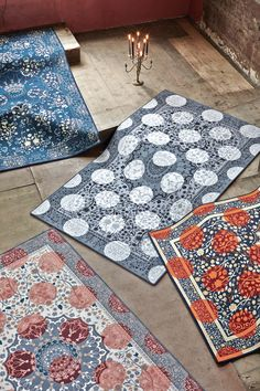 Persian Polkadot Rugs. The iconic Persian rug design is brought up to date with the addition of bright polka dots in this new range of tufted rugs by Mineheart. The contrast of the traditional winding woven floral motifs with the bright geometric pops of colour creates a 21st century take on this classic design.