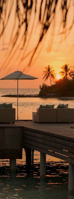 Four Seasons Resort in the Maldives by kathryn Dream Vacations, Vacation Spots, Porches, Places To Travel, Places To See, Cities, Amazing Sunsets, Hotels And Resorts, Beautiful Beaches
