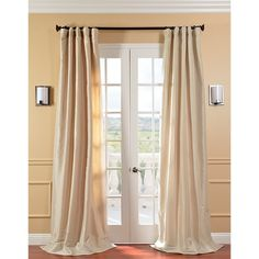 These 84-inch long curtain panels will transform your bedroom. The faux-silk taffeta curtains puddle luxuriously on the floor, giving your window an opulent air. The antique beige color will match any color scheme, and rod pockets make hanging easy.