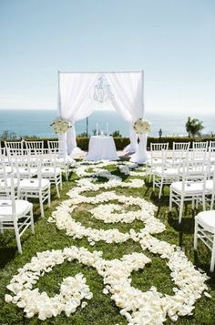 Line the aisle with swirls of rose petals to reflect the ocean's waves. | Luxury Estate Weddings & Events