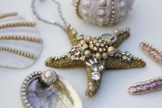 Gorgeous ornaments made with Seashells and Vintage Jewelry and there is a Video Tutorial too! By Debi Beard.