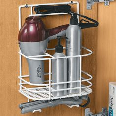 Hair Care Rack. Featuring accommodations for a hair dryer, curling iron, straightener, brushes, combs, and more, this hair care organizer can be mounted to a cabinet door or wall.