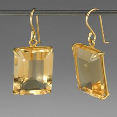 Beautiful in it's simplicity, this Rosanne Pugliese earring features a pair of warm, golden citrines. The rectangular cut gems are set in minimal, recycled 18k yellow gold prongs. The artist uses clean, contemporary lines to create a perfectly balanced earring.