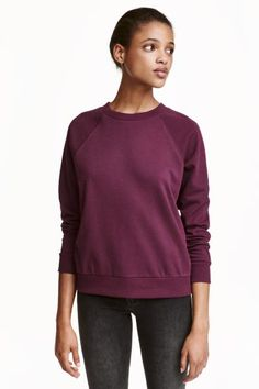 Sweatshirt: Long-sleeved top in sweatshirt fabric with ribbing at the cuffs and hem.