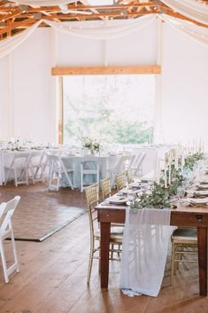 Blue/gray table runner, head table design, gold chairs, blue linens, greenery, wedding reception, barn reception, outdoor wedding