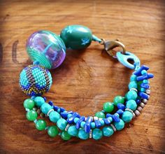 Blue and Green Multi Strand Bracelet with Lampwork and Beaded Bead- Just Gorgeous, love the colous. made by LoreleiEurtoJewelry via etsy
