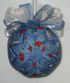 Quilted Ornament - Denim Ladybugs and Daisies - Fabric Ball. Again... I have this fabric, I have the styrofoam balls, I have the directions for making these balls (and have made them before!) I just need to see other's  inspiration of using different fabrics other than the ones I've traditionally used (Christmas fabrics) to come up with something different!