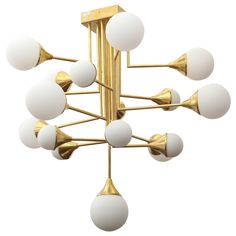 Stilnovo Glass Ball and Brass Chandelier | From a unique collection of antique and modern chandeliers and pendants at https://www.1stdibs.com/furniture/lighting/chandeliers-pendant-lights/