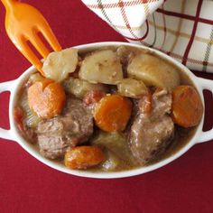 "Slow Cooked Beef Stew-with tons of assorted nutritious vegetables and chunks of lean meat simmering in its own juices this is a simple crock pot meal that""s perfect for the chilly autumn months."