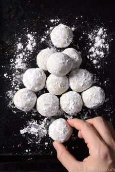 "The ultimate Christmas cookie! Soft and buttery ""melt in your mouth"" cookies are rolled in powdered icing sugar to look just like a snowball Christmas Goodies, Christmas Desserts, Christmas Treats, Christmas Candy, Cookie Desserts, Cookie Recipes, Dessert Recipes, Icing Recipes, Dinner Recipes"