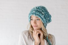 Magical Daisy Hat by Knit Collage - chunky knit hat pattern that calls for our Daisy Chain or Swirl yarns, complete with chunky yarn tassels!