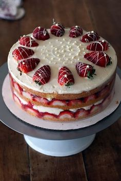 Strawberry Cream Cake, holiday treat! Original recipe by Cooks Illustrated. The pinner I copied this from had soaked the cake with a little Kirsh in addition to putting it in the strawberry filling.