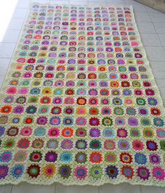 granny square blanket with off white edging by riavandermeulen, via Flickr