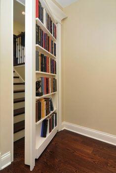 Secret Entrance to the Third Floor.  Love it!  Bi Folding Paint Murphy Door, Hardwood floors, Built-in bookshelf