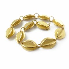 contemporary and bespoke yellow gold bracelet, handmade by Sue Lane Jewellery, UK