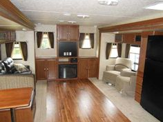 """2015 New Wildwood 37REDS Travel Trailer in Minnesota MN.Recreational Vehicle, rv, Buy any unit and get no payments for 90 days with approved credit!! Unit Features: Total Length: 38' 9"""", Dry Weight: 8,728 lbs.m Aluminum Siding, 2 Opposing Slide in Living Room, Patio Door, Power Jacks, Ducted A/C, Vent in Living Room, Fireplace, Night Shades, Ent. Center, TV Antenna/Booster, Surround Sound, AM/FM/CD/DVD/MP3/USB Ready, Air Matt. Hide-A-Bed Sofa, Swivel Rockers, Dinette Booth, Solid Doors…"""