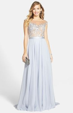"Free shipping and returns on Sherri Hill Cap Sleeve Lace & Chiffon Gown at Nordstrom.com. <p><B STYLE=""COLOR:#990000"">Pre-order this style today! Add to Shopping Bag to view approximate ship date. You'll be charged only when your item ships.</b></p><br>An illusion bodice wrapped in leafy lace and sparked with twinkling crystals is a stunning start for an entirely romantic gown of cobalt blue. A satin band polishes the waist before the ethereal chiffon skirt floats to a dramatic finish."