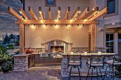 Wood Pergola | Tuscan Architecture | Outdoor Kitchen | String Lights | Patio Lighting | Globe Bulbs | Backyard Ideas
