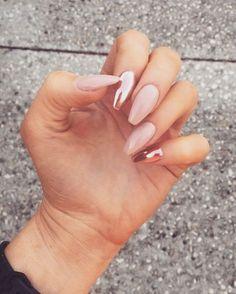 Rose gold chrome nails.