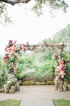 floral and wood altar for an outdoor ceremony