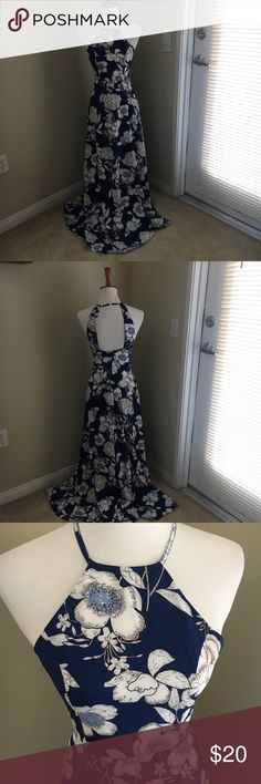 Pretty flowy floral maxi dress Can be dressed up or down! Flows blue floral dress with pretty open back, fabric is a smooth satin-y feel. boutique Dresses Maxi