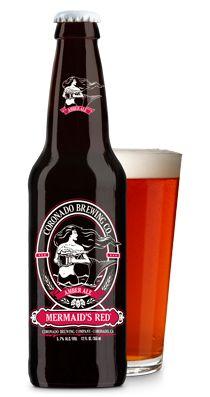Cerveja Coronado Mermaid's Red Amber Ale, estilo American Amber Ale, produzida por Coronado Brewing, Estados Unidos. 5.7% ABV de álcool.