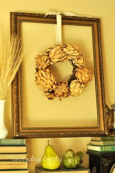 I love this idea of hanging a wreath in an empty frame.... creative juices are flowing!