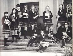 1970s Catholic high school uniforms.... blazer, white blouse, knee socks, and plaid skirt (rolled up, of course)