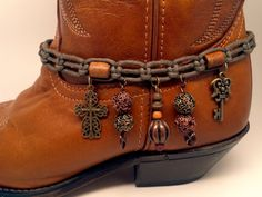 Boot Bracelet  made from vintage cord belt. Copper and brass charms compliment the cord and wooden beads. Funky yet classy for any boot.