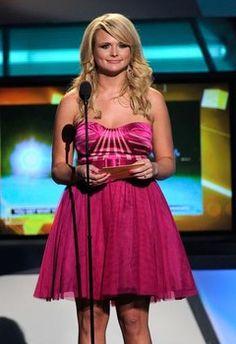 Miranda Lambert at the ACM Awards. Pink dress, pink nail polish. She looks amazing! No wonder it's her favorite color! <3